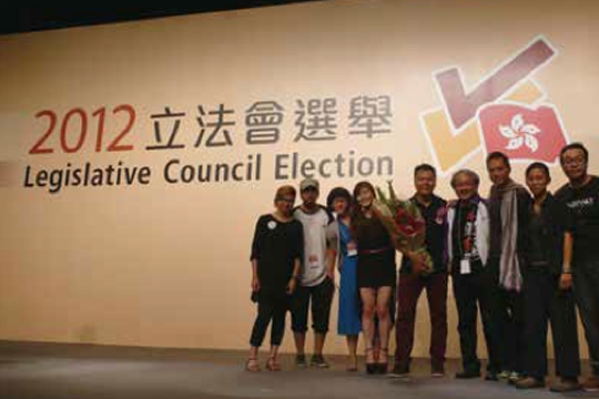 After the polls closed, votes were tallied throughout the night. The campaign teams and supporters took group photos until results were announced. From left: Ivy Chan Ka Yee, Wong Chun Kok, Joanna Lee Hoi Yin, Yeung Seut Ying Yana, Chow Chun Fai, Chan Ching Kiu Stephen, Tse Kin Man Horace, Leung Po-shan Anthony, Wong Kin Wang Kevin