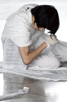 Zoe Sun, Truly False Arts Museum─正治, 2012, performance In a 36 x 25 x 17 cm cube of ice, Zoe Sun froze a three-page petition letter written anonymously to the Taipei City Mayorby a group of Taipei Fine Art Museum employees. She then used various parts of her body to melt the ice, laid the three wet pages of petition on the lobby floor, and left the museum.