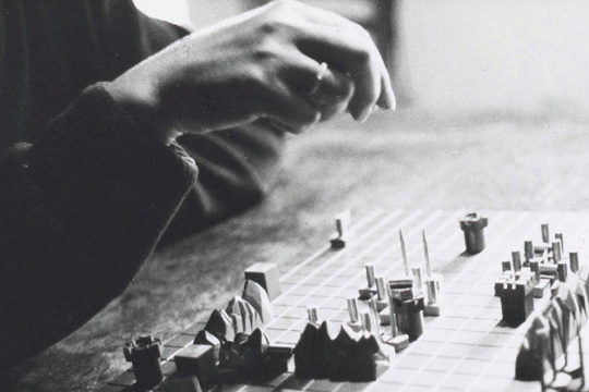 Guy Debord and his wife alice play Le Jeu de la Guerre in August 1987 PHOTO: Jeanne Cornet, Guy Debord archives, manuscript division, BnF