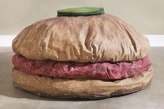 Floor Burger, 1962, canvas filled with foam rubber and cardboard boxes, painted with acrylic paint, 132.1 x 213.4 x 213.4 cm PHOTO: Sean Weaver