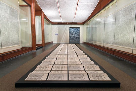 Xu Bing, Book from the Sky, 1987-1991 Installation of hand-printed books and ceiling and wall scrolls printed from wood letterpress type ink on paper Each book, open: 46 x 51 cm; three ceiling scrolls, each: 96.5 x 3500 cm; each wall scroll: 280 x 100 cm Courtesy of the artist