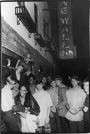 An unidentified group of young people celebrate outside the boarded-up Stonewall Inn (53 Christopher Street, New York) after riots over the weekend of June 28, 1969. The bar and surrounding area were the site of a series of demonstrations and riots that led to the formation of the modern gay rights movement in the United States. PHOTO: Fred W. McDarrah/ Getty Images