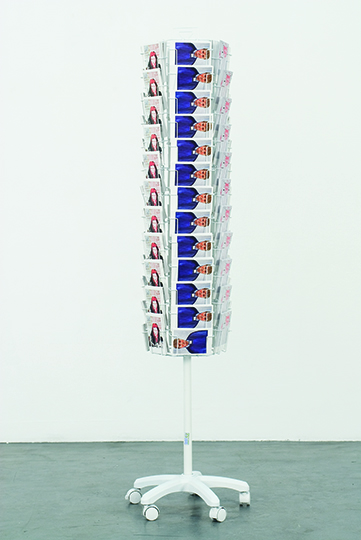 Reena Spaulings, The Complete Dealers, 2013, Postcard rack and postcards, 180 x 23 cm, Courtesy Campoli Presti, London