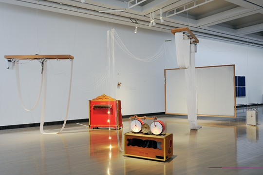 I/0 - Chamber of a musical composer, 2014 Paper, wood, acrylic, dust, motor, blind, fork, organ, drum, bell, toolbox, approx. 294 x 609 x 802 cm PHOTO: Yuko Mohri