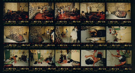 "Performance view of Ricky Yeung, ""Out of Context,"" 1987, 15 Kennedy Road, Hong Kong Courtesy Asia Art Archive"