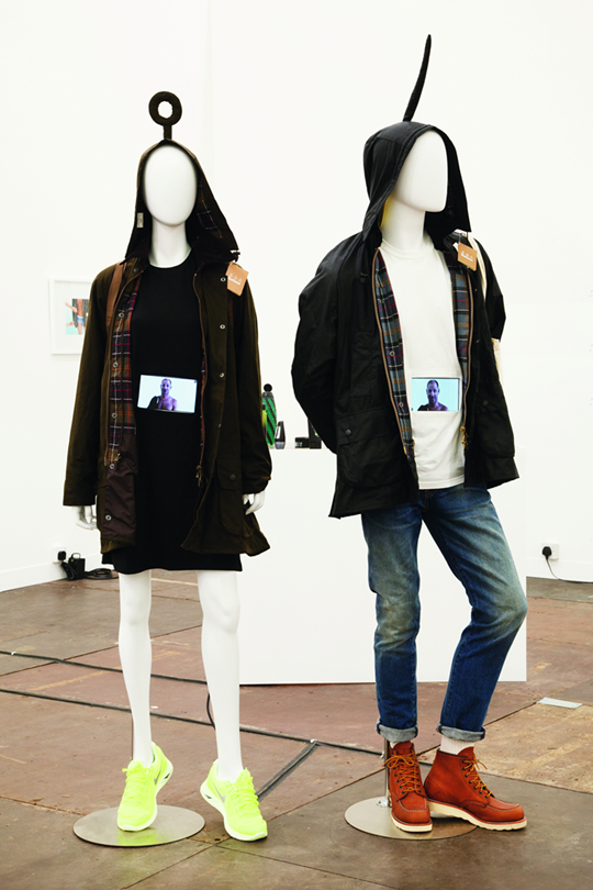 LEFT: Josh Kline, Get the Look: 2011, 2012 modified fiberglass mannequin, Barbour jacket, topshop t-shirt, dress, Fjallraven Kanken backpack, Nike running shoes, screen, media player, speakers, power strip, USB stick, video file 180.3 x 83.8 x 60.9 cm RIGHT: Josh Kline, Get the Look: 2009, 2012 modified fiberglass mannequin, Barbour jacket, Levi's jeans, t-shirt, tote-bag, Redwing boots, screen, media player, speakers, power strip, USB stick, video file 180.3 x 83.8 x 60.9 cm Courtesy 47 Canal, New York PHOTO: Isabel Asha Penzlien