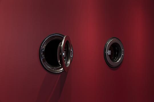 Washing Away of Wrongs, 2014, stainless steel dryer doors, Plexiglas, diffuser, fragrances, 304.80 x 332.74 x 67.31 cm
