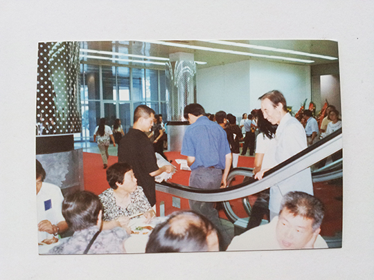 Zhu Fadong handing out flyers at China, International Exhibition Center, July 1999