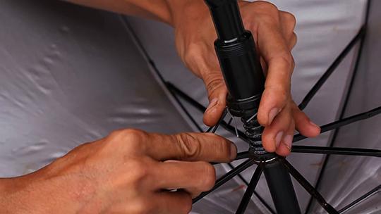 A hand fixing an umbrella