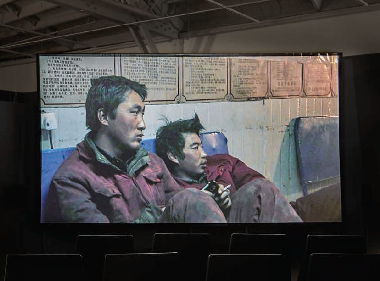 "View of ""Wang Bing: Three Portraits"", 2016, CCA Wattis Institute, Crude Oil, 2008 Courtesy Wang Bing PHOTO: Johnna Arnold"